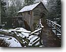 Stock photo. Caption: John P. Cable Grist Mill Cable Mill area, Cades Cove Great Smoky Mountains National Park Tennessee -- world heritage sites parks appalachian winter tree trees hardwood south southern snow cold freezing weather storm stormy smokies historical historic exhibit preserved mills rustic americana wooden building spring buildings alternative energy green power
