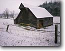 Stock photo. Caption: Hay barn Cades Cove Great Smoky Mountains National Park Tennessee -- world heritage site sites parks appalachian winter tree trees south southern snow snowfalls cold freezing weather storm stormy smokies historical historic exhibit preserved barns building buildings landscape landscapes heritage display