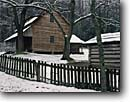 Stock photo. Caption: Tipton Place Cades Cove Great Smoky Mountains National Park Tennessee -- snow snowfall snowstorm storm stormy fence split rail fences homestead homesteads winter wintery cold cabin cabins appalachia appalachian southern southeastern southeast parks world heritage site sites building buildings settlers house houses early