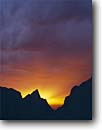 Stock photo. Caption: The Window The Chisos Mountains Big Bend National Park Chihuahuan Desert, Texas -- sunset sunsets spring mountain cloudy clouds parks deserts dramatic weather  storm thunderstorm monsoon monsoons thunderstorms stark isolation solitude spiritual dramatic light spiritual landscape landscapes silhouette silhouettes rugged sunbeams sunbeam