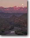 Stock photo. Caption: Moon & Rio Grande River   and Sierra del Carmen Big Bend National Park Chihuahuan Desert, Texas -- deserts rivers mountain mountains peak peaks parks mexican border spring evening light landscape landscapes tourist destination destinations arid  moons sunset sunsets alpinglow alpineglow clear sunny drama dramatic calm time trust hope faith
