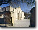 Stock photo. Caption: Mission San Antonio de Valero (The Alamo) Antonio Plaza Historic District San Antonio, Texas -- landscape landscapes scenic scenics scene site sites missions christian historical history early gates open religious building buildings churches attraction attractions spring adobe clear sunny skies preservation gate districts texan morning destination