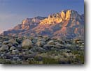 Stock photo. Caption: El Capitan at sunset Guadalupe Mountains National Park Chihuahuan Desert Texas -- united states america landscape landscapes scenic scenics scene fall winter autumn parks canyons mountain range texan sunsets destination destinations attraction attractions deserts clear sunny stark landmark landmarks rocky boulders