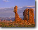 Stock photo. Caption: Balanced Rock,  the Windows   and the La Sal Mountains Arches National Park Colorado Plateau,  Utah -- united states america evening light storm stormy slick rock desert parks arches deserts canyon country plateaus landscape landscapes tourist travel vacation destination destinations arid erosion eroded adversity slickrock sandstone weathering weather