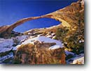 Stock photo. Caption: Landscape Arch   in winter Arches National Park Colorado Plateau,  Utah -- united states america window snow snowy slickrock canyon country sandstone arches parks landscape landscapes tourist travel destination destinations eroded erosion delicate red rock weathered natural features feature geology geologic geological