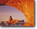 Stock photo. Caption: Turret Arch     from South Window Arches National Park  Colorado Plateau, Utah -- united states america desert deserts red rock canyons country plateaus spiritual landscape landscapes tourist travel destination destinations arches buttes canyon cold snow ethereal family vacation sandstone winter slickrock off season clear sunny