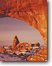 Stock photo. Caption: Turret Arch     from South Window Arches National Park  Colorado Plateau, Utah -- united states america desert deserts red rock canyons country plateaus  landscape landscapes tourist travel destination destinations arches buttes canyon cold strength snow  family vacation window windows sandstone winter slickrock off season sunny