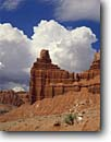 Stock photo. Caption: Chimney Rock Capitol Reef National Park Colorado Plateau,  Utah -- deserts canyon country parks buttes butte southwest colorful erosion landscape landscapes thunderhead white blue canyons dramatic cloud clouds weather skies clear sunny with thunderheads contrast contrasting color colors energy spring walls wall simple