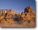 Stock photo. Caption: Eroded hoodoos Goblin Valley State Reserve Colorado Plateau,  Utah -- deserts canyon country parks southwest colorful erosion landscape landscapes rock canyons hoodoo spires spire rock unique weird bizarre sunny clear blue skies destination destinations attraction attractions tourist travel natural formations spring scenics
