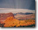 Stock photo. Caption: Waterpocket Fold   and the Henry Mountains Capitol Reef National Park Colorado Plateau,  Utah -- canyon country parks peaks rock desert deserts spring pinyon juniper landscape landscapes arid erosion shaft shafts light sunbeams sunbeam godrays godray ethereal spiritual eternal solitude hope trust patience vast stormy clouds dramatic quiet spectacular