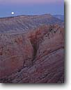 Stock photo. Caption: Waterpocket Fold    from Observation Point Trail Capitol Reef National Park Colorado Plateau,  Utah -- united states america slickrock canyon country sandstone parks landscape landscapes tourist destination destinations eroded erosion desert deserts anticline anticlines upheaval folds moon moons moonset moonsets setting dusk evening light rock parks