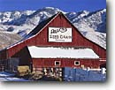Stock photo. Caption: Red Barn in winter   and Bear River Range Cache Valley Great Basin,  Utah -- united states cows cattle hereford herefords ranch ranches frost animal frosty freezing frozen barns wintery snow snowy whitefaced white faces livestock barnyard animals blue skies sunny clear covered peaks peak mountains mountain buildings building
