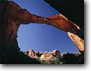 Stock photo. Caption: Escalante Natural Bridge Escalante River Basin Grand Staircase-Escalante National Monument Colorado Plateau,  Utah -- monuments canyon canyons slickrock erosion rock plateaus country travel destination destination geology geologic evolution solitude arch arches bridges tenuous strength strong delicate trust adventure weathered blue skies sunny clear desert deserts spring