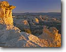 Stock photo. Caption: Escalante River Basin & Boulder Mountain Grand Staircase-Escalante  National Monument Colorado Plateau,  Utah -- monuments canyon canyons slickrock erosion rock plateaus country travel destination destination eroded sunrise petrified sand dunes geology geologic alone evolution solitude upheaval serenity serene desolate landscape landscapes sunny clear skies spring