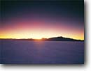 Stock photo. Caption: Bonneville Salt Flats   and Silver Island Mountains at twilight Great Basin Desert,  Utah -- united states america deserts range brilliant salty flat pastel rays light ethereal landscape landscapes scenics scenes sunbeams sunbeam evening quiet places aura sunset sunsets