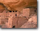 Stock photo. Caption: Moon House,  Road Canyon Cedar Mesa Road Canyon Wilderness Study Area Colorado Plateau,  Utah -- indian canyons country deserts pueblos ruin ruins native american historic parks desert anasazi southwest southwestern construction rock structure mysterious dwellings window remote ancient building buildings stone wildernesses areas cliff dwelling spring