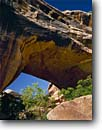 Stock photo. Caption: Kachina Bridge White Canyon, Cedar Mesa Natural Bridges National Monument Colorado Plateau,  Utah -- monuments canyons slickrock erosion arches strong opening pristine rock country destination destination desert spectacular strength massive indian balance arch sunny blue clear landscape landscapes scenics scenic water over deserts varnish looking sacred