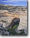 Stock photo. Caption: Sipapu Natural Bridge White Canyon Natural Bridges National Monument Colorado Plateau,  Utah -- monuments canyon canyons slickrock erosion arch arches bridges natural rock country hiking destination destination strong strength window massive hole landscape landscapes scenics scenic looking through spring sunny looking down clear indian native sacred