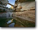Stock photo. Caption: Owachomo Natural Bridge Armstrong Canyon Natural Bridges National Monument Colorado Plateau,  Utah -- monuments canyon canyons slickrock erosion arch arches rock hiking destination destination pool pools creek creeks reflection reflections calm peace peaceful landscape landscapes scenics scenic spring sunny clear perfect stunning calm native sacred