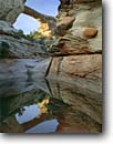 Stock photo. Caption: Owachomo Natural Bridge Armstrong Canyon Natural Bridges National Monument Colorado Plateau,  Utah -- monuments canyon canyons slickrock erosion arch arches rock indian country hiking destination destination pool pools creek creeks reflection reflections calm peaceful landscape landscapes scenics scenic spring sunny clear perfect stunning calm sacred
