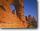 Stock photo. Caption: Titan Window and Fisher Towers Colorado Riverway Colorado Plateau Utah -- desert deserts rock canyons country  plateaus landscape landscapes tourist travel destination destinations canyon buttes butte sandstone arches varnish sunny blue skies clear slickrock scenic scenics named formations formation landmarks landmark