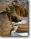 Stock photo. Caption: Navajo sandstone designs Clear Creek Zion National Park Colorado Plateau,  Utah -- scouring scoured waterfall waterfalls canyon canyons country moody tourist destination destinations landscape landscapes rock redrock erosion slickrock creeks carving through rivers river artistic nature solid west evolution solid strong strength motion