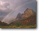 Stock photo. Caption: Rainbow over Zion Canyon   from Watchman Meadow Zion National Park Colorado Plateau, Utah -- deserts canyon country parks clouds buttes butte cloud storms storm stormy dramatic skies southwest rainbows cloudy rain rainy summer spire spires unique united states colorful erosion distance rod rock