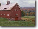 Stock photo. Caption: Red Barn and Dairy farm Mad River Valley Waitsfield Vermont -- east country countryside autumn fall trees destination travel north northeast quaint colors color maple   american rural peace peaceful picturesque barns rustic colours colour farms building buildings foliage wooden cloudy overcast doors ranching farming