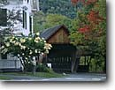 Stock photo. Caption: The Middle Covered Bridge (1969) Woodstock Windsor  County New England,  Vermont -- flower flowers northeast northeastern landmark landmarks urban bridges americana historic historical rural transportation road roads backroads building buildings foliage modern eastern fall autumn
