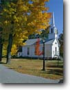 Stock photo. Caption: Red maple   and village church Grafton, Winham County New England, Vermont -- fall autumn worship country road steeple white quaint churches roads maples northeast northeastern places  worship villages town towns sunny clear blue crisp building buildings religous sympols americana backroads baokroad towns town small america