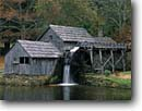 Stock photo. Caption: Mabry Mill Blue Ridge Parkway Blue Ridge Mountains Virginia -- race races quaint nostalgia nostalgic east south southeast mills historic historical buildings america rural waterwheel waterwheels flume flumes diversion water diversions hydro power grind grinding alternative energy autumn fall landscape scenics green