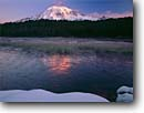 Stock photo. Caption: Mt. Rainier  from Reflection Lakes Mt. Rainier National Park Cascade Range, Washington -- peak snow reflection parks mountains lake mountain peaks reflections volcano volcanos volcanoes ranges cascades landscape landscapes tourist travel destination destinations winter frozen freezing snow sunny clear blue skies scenics scenic cold