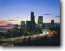 Stock photo. Caption: Downtown and Interstate 5 at dusk from Beacon Hill Seattle Washington -- city cityscapes cityscape skyline skylines buildings building urban landscape landscapes contrast united states america commercial commerce urban night lights dusk interstates pacific northwest northwestern clear cities scenic views view freeways freeway