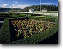 Stock photo. Caption: Formal Garden, Guardhouse Commissary  and Garrison Bay San Juan Island National Historical Park San Juan Islands,  Washington -- forts historic historical memorials pacific coast safety protection protected northwest northwestern parks gardens flagpole military protected protection guarded fences white pickett picket sunny blue skies clear plot building buildings history safe