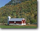 Stock photo. Caption: Red Barn in South Branch Potomac River Valley   and North Fork Mountain   in Monongahela National Forest Allegheny Mountains,  West Virginia -- fall autumn color colors americana   nostalgia appalachia building ranching farming farm ranch silo silos barns agriculture rural pastoral independent independence family sunny clear skies blue farms bucolic foliage crisp faith trust