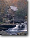 Stock photo. Caption: Glade Creek Grist Mill Babcock State Park Allegheny Mountains West Virginia -- creeks mills waterwheel waterwheels fall autumn color colors americana parks maple nostalgia appalachia cascade building buildings historic historical motion progress creeks rustic quaint time durable alternative energy foliage time turning green power