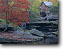 Stock photo. Caption: Glade Creek Grist Mill Babcock State Park Allegheny Mountains West Virginia -- creeks mills waterwheel waterwheels fall autumn color colors americana parks nostalgia appalachia waterfall waterfalls building historical appalachian american alternative energy historic buildings producing country independence independant power green