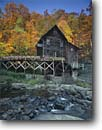Stock photo. Caption: Glade Creek Grist Mill Babcock State Park Allegheny Mountains West Virginia -- creeks mills waterwheel waterwheels fall autumn color colors americana parks maples nostalgia appalachia waterfall waterfalls building buildings historic historical industry flumes power energy production flume grinding sunny clear rustic blue skies