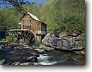 Stock photo. Caption: Glade Creek Grist Mill Babcock State Park Allegheny Mountains West Virginia -- tourist destination destinations attraction attractions historic historical buildings building landscape landscapes mills parks spring grinding green alternative energy power water powering wheel time traditional nostalgia wheels independence scenics