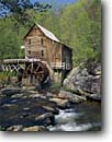 Stock photo. Caption: Glade Creek Grist Mill Babcock State Park Allegheny Mountains West Virginia -- tourist destination destinations attraction attractions historic historical buildings building landscape landscapes mills parks spring grinding green alternative energy power water powering wheel time traditional nostalgia wheels independence sunny