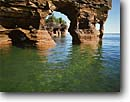 Stock photo. Caption: North end of Devils Island Lake Superior Apostle Islands National Lakeshore Bayfield County,  Wisconsin -- cave eroded erosion national lakeshores great lakes united states america eroded adventure parks weathered weathering outdoor landscape landscapes lakeshore kayaking canoeing area areas region islands spring clear summer sunny blue sky skies water