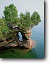 Stock photo. Caption: Devils Island Apostle Islands National Lakeshore Lake Superior Bayfield County,  Wisconsin -- cave erosion national lakeshores great lakes region midwest midwestern united states america eroded weathered destination shoreline shorelines balance balanced landscape landscapes arch arches islands canoeing kayaking area areas outdoor destinations