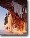 Stock photo. Caption: Sea caves at Squaw Bay Apostle Islands   National Lakeshore Lake Superior, Wisconsin -- united states america parks lakeshores ice icefall icicles winter falls trees great lakes snow frozen cold bitter landscape landscapes islands midwest midwestern shore beach region clear blue sky skies sunny really freeze  cave destination destinations