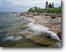 Stock photo. Caption: Sand Island Lighthouse Lake Superior Apostle Islands National Lakeshore Wisconsin -- lighthouses stations landscape landscapes scenic scenics buildings building summer light station house houses shore isolated alone trust parks flag flags american great lakes lakeshores parks waves rocky rugged shoreline lakeshores clear water
