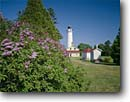 Stock photo. Caption: Lilac and Cana Island Lighthouse Lake Michigan Door County Wisconsin -- lighthouses stations landscape landscapes scenic scenics buildings building summer light station house houses trust great lakes lakeshores lakeshores clear sunny blue skies tower lilacs homesteads  home homes domestic domecile