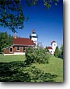 Stock photo. Caption: Sherwood Point Lighthouse Door Peninsula Door County Wisconsin -- lighthouses stations landscape landscapes scenic scenics buildings building summer light station house houses trust great lakes lakeshores lakeshores clear sunny blue skies tower lilacs lawn fences fence