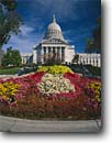 Stock photo. Caption: Wisconsin State Capitol Madison Dane County Wisconsin -- flower flowers capital capitals midwest midwestern united states america landmark landmarks urban garden gardens spring dome domes government governments heartland capitol capitols sunny blue skies clear building buildings govermental seat trust wisdom