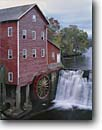 Stock photo. Caption: Dells Mill and Pond Bridge Creek   near Augusta Eau Claire County, Wisconsin -- grist gristmill gristmills waterfall waterfalls americana nostalgic nostalgia fall autumn upper midwest midwestern cloudy historic historical building buildings county hydro power rural waterwheel waterwheels energy alternative landscape landscapes green