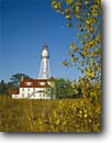 Stock photo. Caption: Rawley Point Lighthouse Point Beach State Forest Lake Michigan Wisconsin -- tourist destination destinations attraction attractions sunny blue quaint northern lighthouses station stations light calm clear docks tower lights great lakes fall autumn moon moons landscape landscapes midwest midwestern scenic scenics