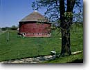Stock photo. Caption: Round barn Trempealeau County Wisconsin -- americana nostalgic nostalgia united states building buildings landscape landscapes scenic scenics american farms barns harvest harvesting agriculture midwest midwestern historic historic clear sunny blue skies road roads byway byways backroad backroads